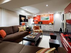 Spiced-Up Basement    To create a space with the energy and warmth of a Mexican cantina, Candice starts by grounding the basement with durable tile that has the look of wide-plank hardwood. Color plays a big part in this space
