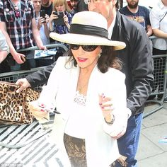 Megastar: The 82-year-old looked ever youthful as she put on a decadently sassy display in a straw boater and glamorous dark shades