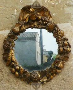 Small mirror with carved wood frame. Isn't it pretty!