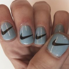 Nike nails! To create this look use a base coat of your chose then print out the Nike sign to fit your nail. Next place the printed picture over your nail and use alcohol on a cotton ball, press cotton ball firmly on nail for a minute then remove image should stay!