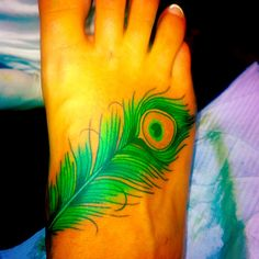 peacock feather tattoo...i either want it here, or wrapping from the back of my neck to behind my ear