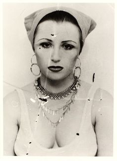 I've always been obsessed with Cindy Sherman's use of makeup in her art to change and morph her character. Fascinating