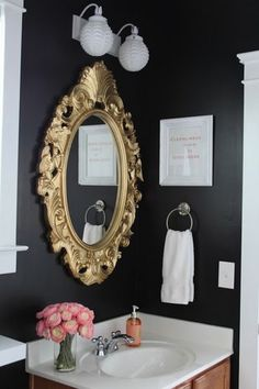 I like the dark walls behind the gold mirror and the crisp whites!  DOING THE LAUNDRY ROOM THIS COLOR! Have not seen others use this dark of a color!