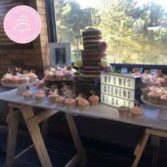 Three tiered naked wedding cake - Victoria sponge, chocolate cake and carrot cake with 80 cupcakes with grey, pink and ivory icing