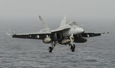 """GULF OF OMAN (July 1, 2013) –An F/A-18E Super Hornet assigned to the """"Argonauts"""" of Strike Fighter Squadron (VFA) 147 prepares to land on the flight deck of the aircraft carrier USS Nimitz (CVN 68). Nimitz Strike Group is deployed to the U.S. 5th Fleet area of responsibility conducting maritime security operations, theater security cooperation efforts and support missions for Operation Enduring Freedom. (U.S. Navy photo by Mass Communication Specialist Seaman Apprentice Kelly M. Agee…"""