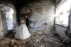 Newly-wed Syrian couple Nada Merhi, 18, and Hassan Youssef, 27, pose for their wedding pictures amid heavily damaged buildings in the war ravaged city of Homs. A Syrian photographer uses the destruction of Homs as a backdrop to show that life is stronger than death. (Joseph Eid/AFP/Getty Images)