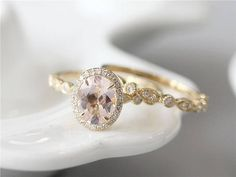 Ring Details: *Metal Type of this ring is in Solid 14k Yellow Gold (Rose Gold & White Gold are available). *Main Stone is Natural Oval Cut Morganite The measurement is 7x9mm The clarity is VS. The Band Details: This band ring is made up gold and diamond Metal type is in Solid 14k Yellow Gold (Rose Gold & White Gold are available). Natural Diamond about 0.12ctw,Round Cut,SI in the clarity and H in the color. . *Size: Available for choose *We offer nice gift box with package for...