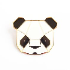 PANDA BROOCH This precious little Panda will bring a touch of geometric heaven to your winter jacket. Made from gilt metal and soft enamels wit...