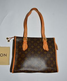 Authentic Louis Vuitton Monogram Poping Court Haut with the original dust bag at a low price my site!!  Please visit my site for more of authentic brand bags:  grantaboutique.com