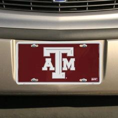 """Texas A Aggies Maroon Metal License Plate by Football Fanatics. Save 13 Off!. $6.99. Made in the USA. Metal body. Team logo and colors. 12"""" x 6"""". Tag is approximately 1/8"""" in thickness. Texas A Aggies Maroon Metal License Plate12"""" x 6""""Made in the USAMetal bodyTeam logo and colorsOfficially licensed collegiate productTag is approximately 1/8"""" in thicknessTag is approximately 1/8"""" in thickness12"""" x 6""""Made in the USATeam logo and colorsMetal bodyOfficially licensed collegiate product"""