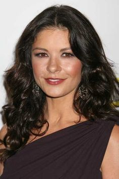 Catherine Zeta Jones sexy long hairstyle with curls