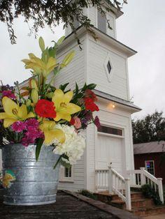 Rain buckets with flowers.