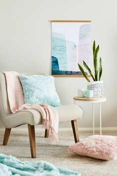 mint and blush faux fur cushions and throws on beige occasional chair and cream rug