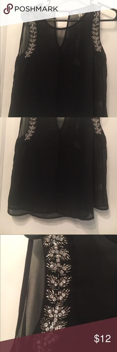 Sheer sleeveless black top Never before worn sheer sleeveless black top! Original tags on item.  Price tags were removed because the top was a gift. Tops Crop Tops