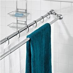 """When I saw this I had one of those """"how did I not know about these"""" moments!  It's a double shower rod - one bar can be used for towels or use the other side for your fancy shower curtain and the other for the vinyl one"""