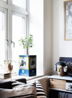 A casual apartment in Sweden via stadshem This olive tin can used as a planter has to be my favorite item in this apartment. It reminds me of the old mediterranean village yards that are crammed with those. Looks equally cool in a town apartment, don't you agree?