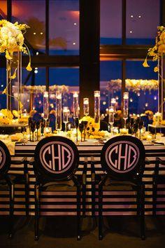 Yellow, black, white sunflower theme wedding reception with custom monogrammed chairs   Photo: Bee Photographie