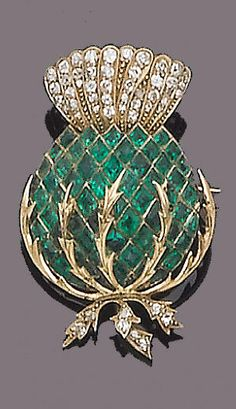 An early 20th century emerald and diamond brooch The thistle set with calibré-cut emeralds and single and rose-cut diamonds, length 3.5cm.