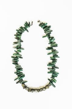 Summit Street Necklace  This natural green jade tusk stone necklace features 11 raw unpolished pyrite beads in the center and has an antique brass button clasp. The necklace hangs near the collarbone.  Perfect to wear on its own or layered with one of my long pyrite necklaces.