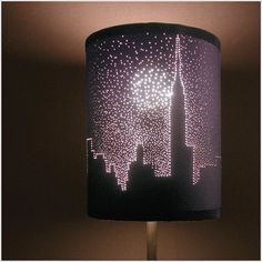 If you have a simple dark shaded lampshade you can simply turn it into an amazing piece of art. Draw a skyline silhouette or star constellation on a piece of paper first and fix it on the lampshade with tape. After that, using common pins make holes in the lampshade along the lines of the silhouette. You can easily turn a light color lamp shade into dark with textile paint.