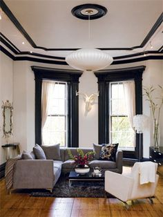 For an updated take on traditional decorating, leave the walls white and paint the moldings and window frames a bold color.