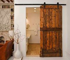 Space saving - industrial or old sliding doors.  Saw an industrial one used in a kitchen on Property Brothers.