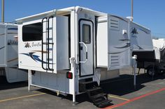 TCM takes an up close look at the Eagle Cap 1165 triple-slide truck camper, the first camper with a kitchen peninsula. It's a triple-slide review!