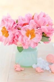Pink orange flowers, blue vase
