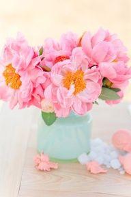 Pink orange flowers, blue vase