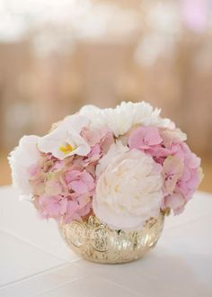 Blush ivory and gold wedding centrepiece Created by Akiko Floral Artistry Inc.  Photo credit:  Milton Photography #phalaenopsis #orchids #blush #gold #blushandgold #ivory #tulips #roses #peonies #hydrangea #wedding #flowers