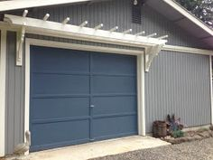 How to Build a Trellis over a Garage Door - this is an easy and economical project that adds so much curb appeal to your home - Blue Roof Cabin