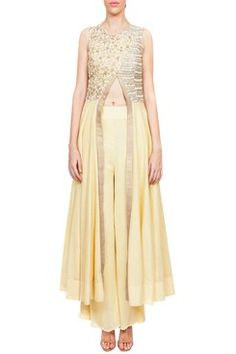 Featuring a lemon yellow overlap anarkali in cotton silk base with fully floral embroidered yolk and gold border along slit. It comes alogng with a pair of matching georgette palazzo pants By RIDHIMA BHASIN .Shop now-www.carmaonli... #carma #carmaonlineshop #style #fashion #designer #indianfashion #RIDHIMABHASIN #couture #shopnow #indianwear #pretty #girly #onlineshopping #instashop #beautiful #outfitpost #ootd #ootn #partywear #eveningwear #whattowear  #OOTN #summerdressing