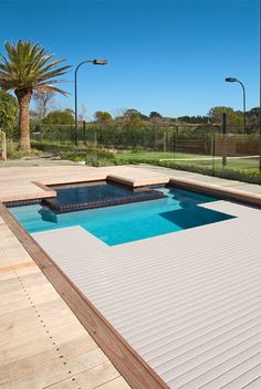 Love the decking surrounding the pool and the auto safety cover that a child can stand on.