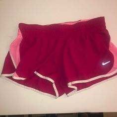 Ladies Nike Dri Fit Running Shorts  dark pink color with pink and white trim Size  Large Running Shorts, Nike Shorts, Gym Shorts Womens, White Trim, Nike Dri Fit, Pink Color, Workout, Dark, Fitness