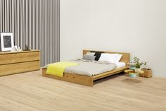 Invites to relax: solid wood bed MO by Philipp Mainzer. Chest of drawers: IMARI. Side tables: HABIBI and ENOKI. / www.e15.com #e15 #oak #yellow #stripes #brass