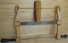 bowsaw is carved and turned made of pecan by FREEMANWOODWORKING