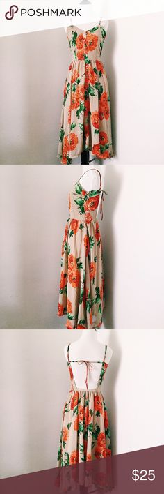 Floral Dress MIDI floral dress. Has an open back and zipper on the side. Great condition Dresses Midi