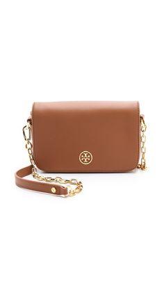Tory Burch purse. Metal hardware lends a polished finish. http://beta.shoptagr.com/tags/GmYcziPTiH7e58ES9_Fu7w