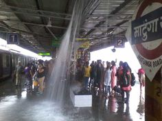 """This dramatic picture of monsoon rains breaking through the roof of a Mumbai train station came to us from CJ Ravi Narayan.  He says, """"I clicked this picture at Matunga Road Railway station, Mumbai. The leaking roof caused a lot of inconvenience to passengers waiting at the station."""""""