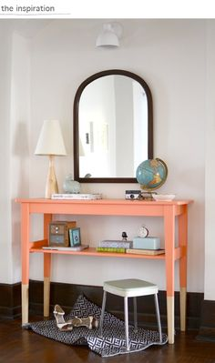 Loving the pop of peach off the white wall!