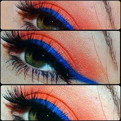 Orange eyeshadow with blue liner!