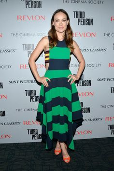 """Olivia Wilde wearing our midnight and calypso green striped rugby dress with our yellow and burgundy bandeau from the Spring '15 Stella McCartney collection at Sony Pictures Classics' New York premiere of """"Third Person.""""  Photo courtesy of Getty Images."""