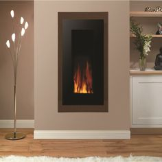 Gazco Studio 22 Electric E Motiv Black Glass at Homecare Showroom Darlington, North Yorkshire, County Durham, Teesside Inset Fireplace, Fireplace Surrounds, Inset Electric Fires, Electric Fireplace, Tree Chair, Oak Mantle, Living Room With Fireplace, Beautiful Wall, Simple House