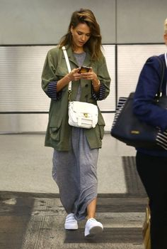 Actress Jessica Alba and her husband Cash Warren arrive on a flight in Miami, Florida on October 21, 2015.