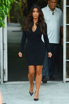 Kim Kardashian... God I need to get my dress tailored