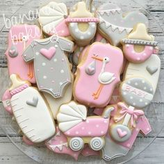 Baby shower cookies.  Stork, onesies, hearts, pacifier, bottle, baby carriage.   Adorable cookies!