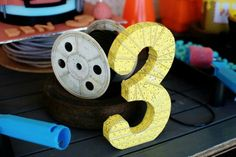 We covered the number 3 in tape measure printed paper