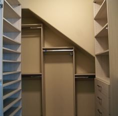 Hanging sections with descending heights fit perfectly under this closet's slanted ceiling.