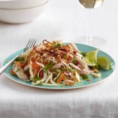 Crunchy Vietnamese Chicken Salad | Eric and Sophie Banh like to poach the chicken for this vibrant dish, then toss the salad with a homemade scallion oil.  To save time, use store-bought rotisserie chicken and skip the scallion oil; the salad already gets plenty of flavor from the spicy, vinegary dressing and abundance of fresh herbs.