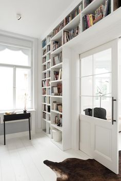 bookcase in study room with sliding door